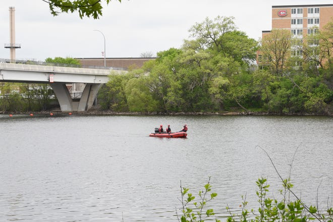 St. Cloud firefighters search the Mississippi River above the St. Cloud hydro dam for a 9-year-old boy reported missing Thursday, May 21, 2020.