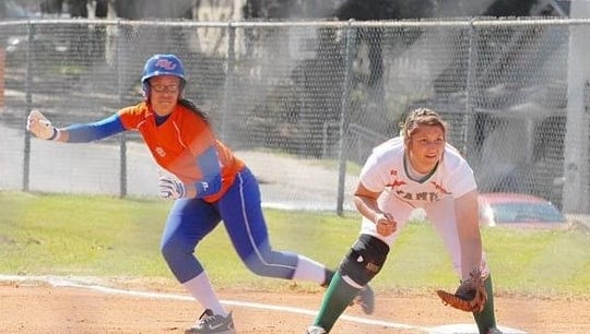 Former FAMU softball player Taylor West (now Sherrod) keeps a runner close at first base.