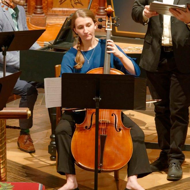 Rebekah Franklin playing the cello with the Baroque Ensemble.