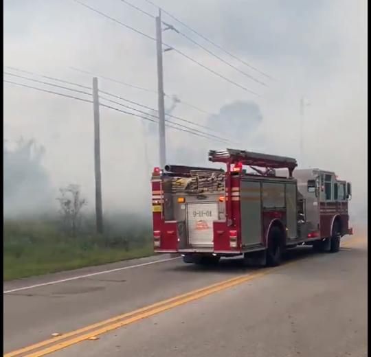 A brush fire shut down CR-512 on Thursday, May 21, 2020.