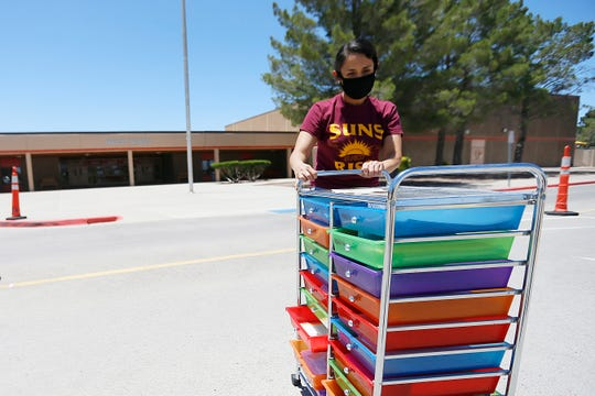 Stephanie Corral, third-grade teacher at Hueco Elementary, packs Wednesday, May 20, 2020, at the school in Socorro, Texas. Corral cleaned out her classroom after the school year ended abruptly because of the pandemic.
