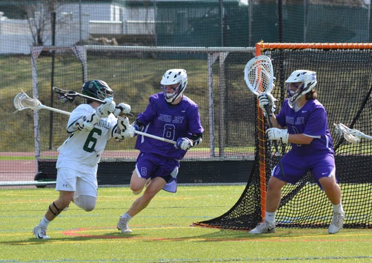 Pleasantville attackman Jake Coleman gets ready to unload a shot against John Jay-CR during an 11-9 loss on April 13, 2019 at Pleasantville High School.