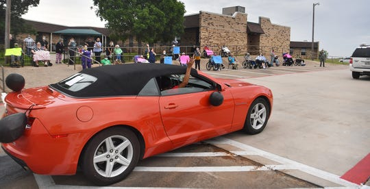 Midwestern Healthcare Center organized a parade for the residents Thursday morning. Families decorated cars, made signs and honked their horns as they circled the property waving to their loved ones.