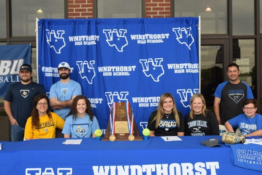 Windthorst seniors Abby Brown (seated, second from left) and Laynie Brown (seated, third from left) -- no relation -- each signed a letter of intent to play softball at the college level Thursday. Abby Brown signed with East Texas Baptist University -- an NCAA Division III program located in Marshall. Brown is a two-time Red River Diamond Dozen member as a catcher, earning Offensive Player of the Year honors as a junior. Laynie Brown signed with Vernon College. She's also a two-time Diamond Dozen selection as the Trojanettes' pitcher. Both players were key figures in the Trojanettes' run to the state tournament last season.