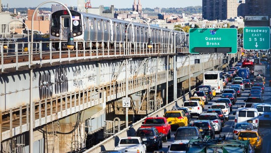 New York City, USA - October 15, 2015: Heavy traffic back ups on the Williamsburg Bridge while a subway train passes by during rush hour in New York City on October 15, 2015. The bridge connects Lower Manhattan with the borough of Brooklyn.