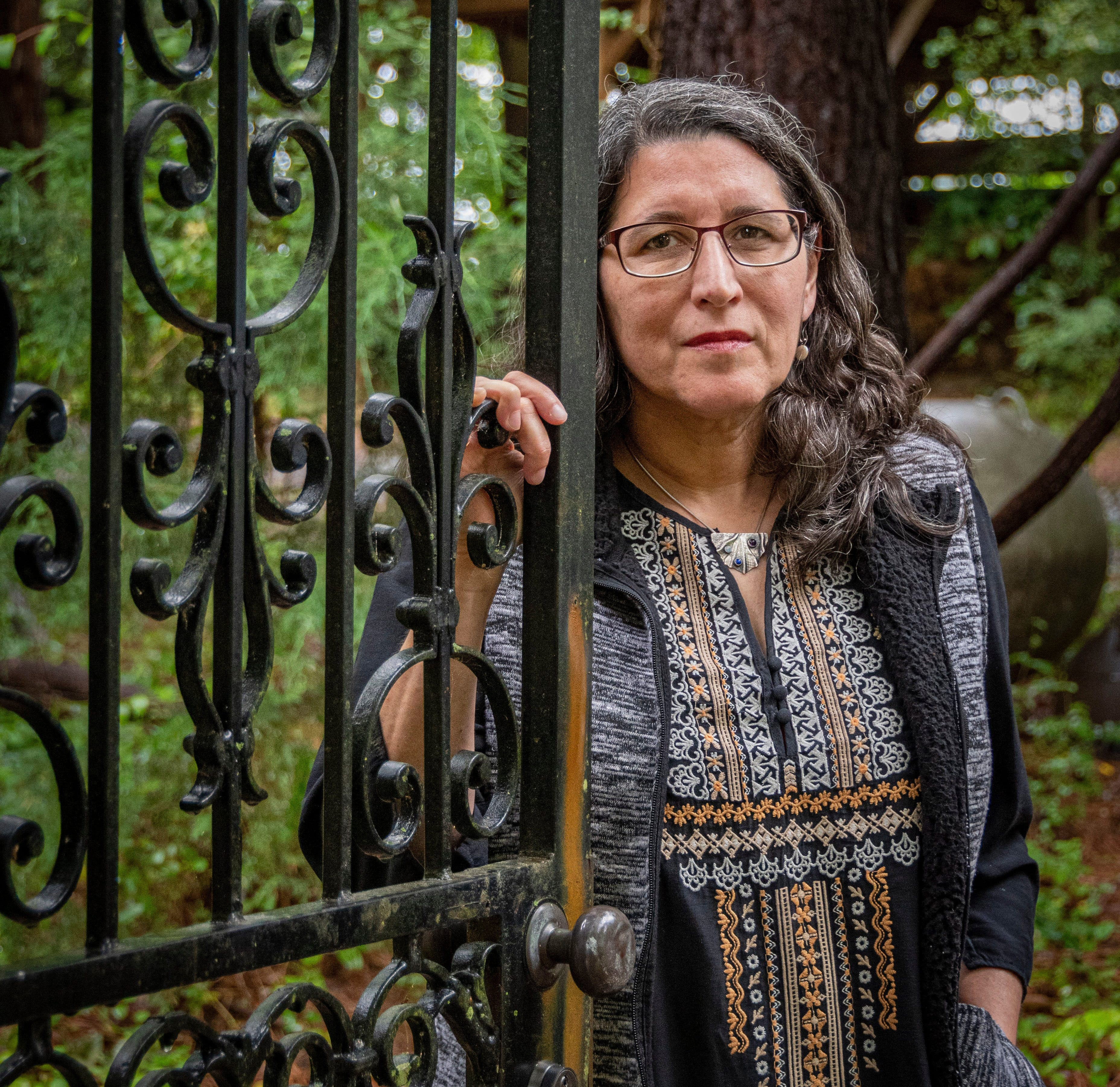 Ilana Dubester, Executive Director of The Hispanic Liasson, poses for a photo at her home in Pittsboro, NC.