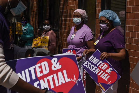 Nursing home workers hold a vigil outside of the Downtown Brooklyn Nursing and Rehabilitation Center on May 21, 2020 in the Brooklyn borough in New York City. Nursing home workers are advocating for hazard pay, better access to personal protective equipment and respect from their employers, said a representative from the Healthcare Workers Union.