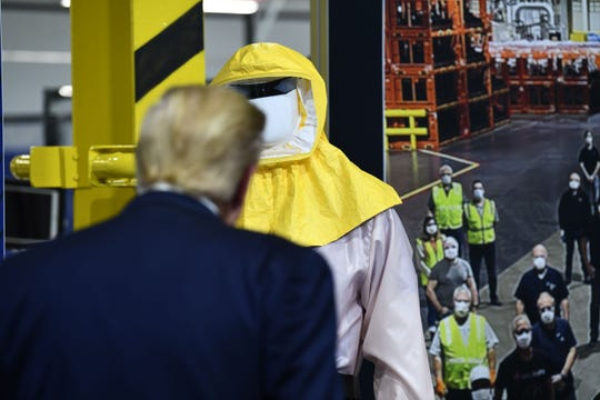 President Donald Trump tours the Ford Rawsonville Plant that was converted to making personal protection and medical equipment in Ypsilanti, Mich., on May 21.