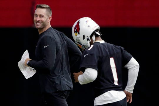 Arizona Cardinals head coach Kliff Kingsbury, left and shown in 2019, may be able to hold a practice with Kyler Murray and other players in the coming weeks.