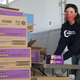 Stephanie Toal from OceanFirst helps prepare a delivery of 10,000 boxes of Girl Scouts Cookies to cheer families served by Fulfill.