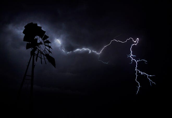 Lightning crackles across the sky above the windmill along the railroad tracks in Merkel on Thursday. Wind and a little rain accompanied the system as it blew in from the west. More thunderstorms are predicted next week.