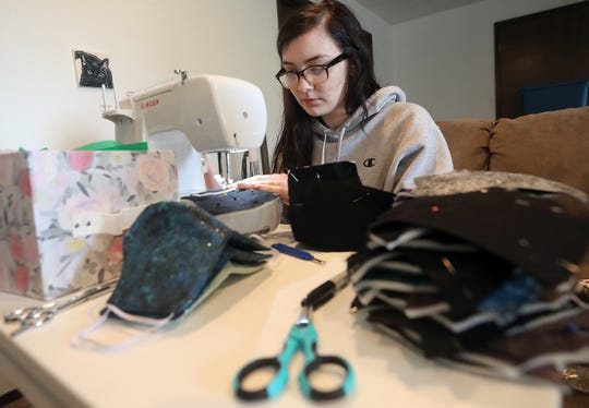 Brittany Singer sews face masks in the living room of her Central Kitsap home on Thursday, May 21, 2020.