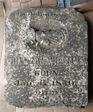 Juleyan Williams' grave marker before restoration.