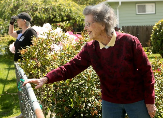 Yula May Harris, 100, smiles at a neighbor driving past her  Manette home on Friday, May 22, 2020.