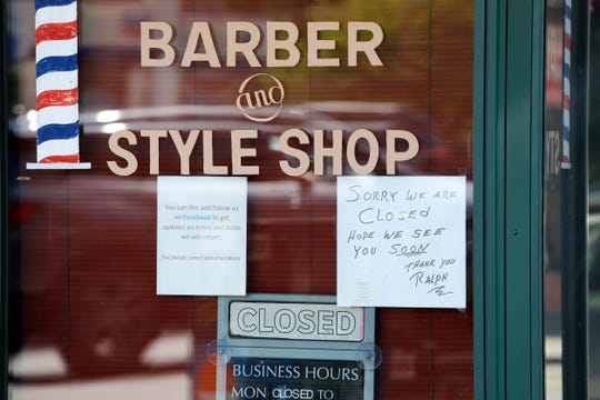 A barber shop remains closed because of the coronavirus outbreak Tuesday, May 19, 2020, in Seattle. Washington state Gov. Jay Inslee on Tuesday announced $10 million in grants to small businesses in industries particularly hard-hit by the COVID-19 outbreak. They include restaurants, hair salons, fitness studios and theaters.