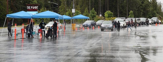 Vehicles line up as the Port Gamble S'Klallam Tribe's drive-thru COVID-19 testing site prepares to open in The Point Casino & Hotel parking lot on Thursday, May 21, 2020.