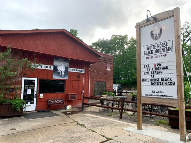 A sign outside of White Horse Black Mountain advertises a livestream event while the venue remains closed amid the coronavirus on May 21.
