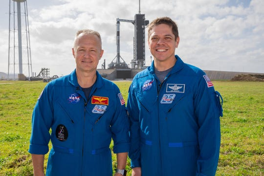 Astronauts Doug Hurley and Bob Behnken in front of the SpaceX Flacon 9 that will carry them to the ISS on their historic flight.