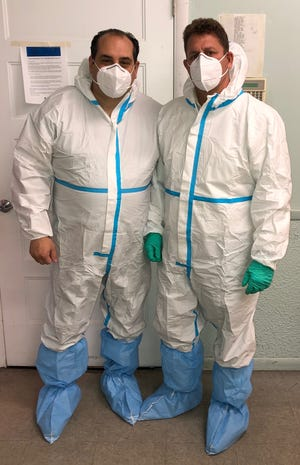Funeral directors Eric Daniels (right) and Peter Franzese worked together last month handling a surge of coronavirus victims on Long Island. Both fell ill with COVID-19 and are still recovering.