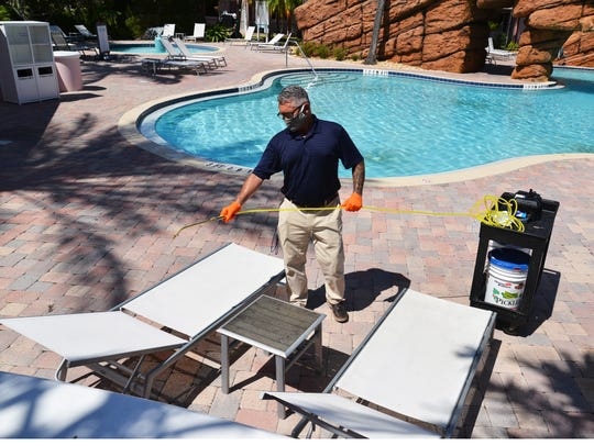 Michael Golesborough, chief engineer at the Radisson Resort at the Port in Cape Canaveral, sprays disinfectant and a sealer on pool furniture. The hotel treats all areas of the hotel with the disinfectant and sealer. Like many hotels in the area, the Radisson was gearing up for a busy Memorial Day weekend, followed by a high-profile SpaceX launch.
