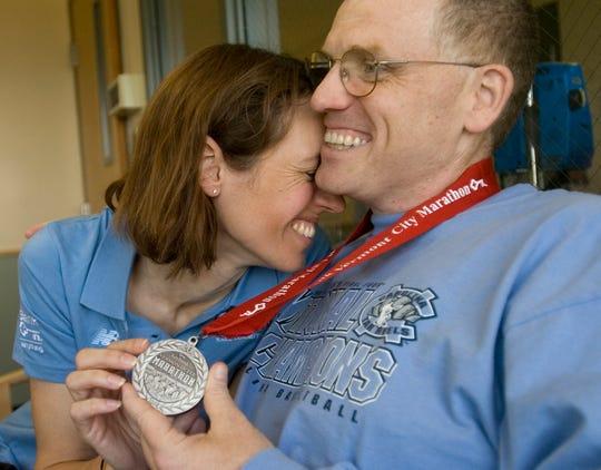 Marathon runners Hardin Watkins and Liz Jackson of Garner, N.C. are light-hearted despite Hardin's near-fatal collapse before the finish line at the 2008 Vermont City Marathon.