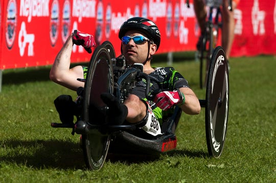 Handcyclist Jeremy Shortsleeve pumps his fist as he crosses the finish line first during the 26th Keybank Vermont City Marathon on Sunday May 25, 2014 in Burlington, Vermont.