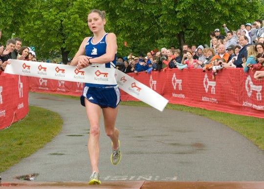 Heidi Westover smashes the women's course record at the 2009 Vermont City Marathon. Westover, a New Hampshire resident, won at VCM six times.