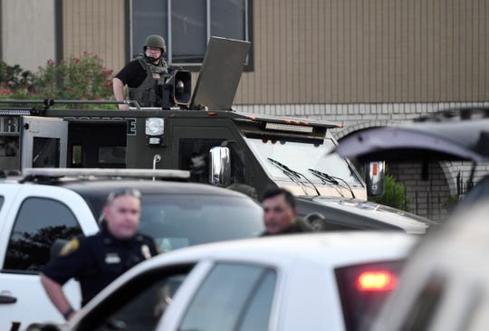 Corpus Christi police SWAT and FBI are surrounding a home near Saratoga Boulevard, Thursday, May 21, 2020, in Corpus Christi, Texas. Lt. Michael Pena, spokesperson for the police department, could not confirm if it was related to an active shooting at Naval Air Station - Corpus Christi on Thursday morning.