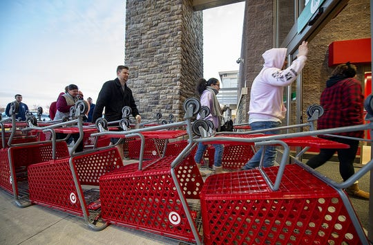 Black Friday shoppers enter Target in Mount Laurel, through a makeshift chute, as the store opens for business on Friday, November 29.