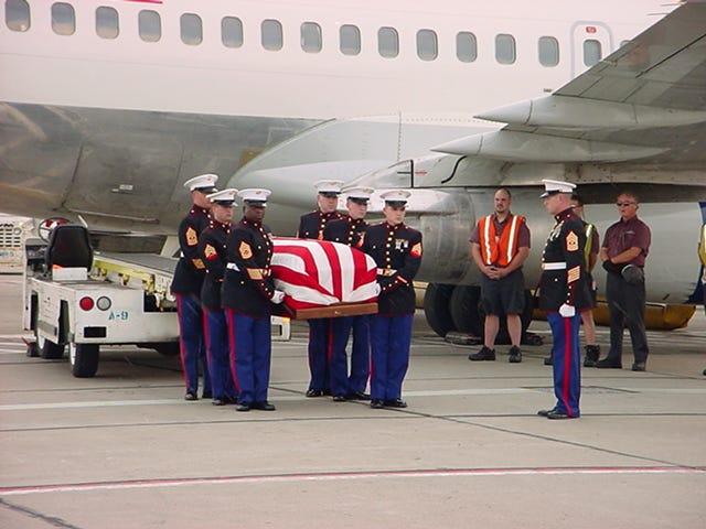Marines carry Taylor Prazynski's American flag-covered casket after he arrived in Cincinnati.