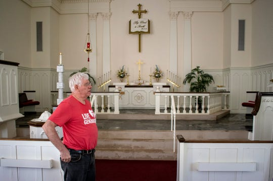 Pastor Paul Schneider says families are heartbroken that floodwaters went all the way up to the altar after nearby dams broke. He is pictured here at at Holy Scripture Lutheran Church in Midland on Friday, May 22, 2020.