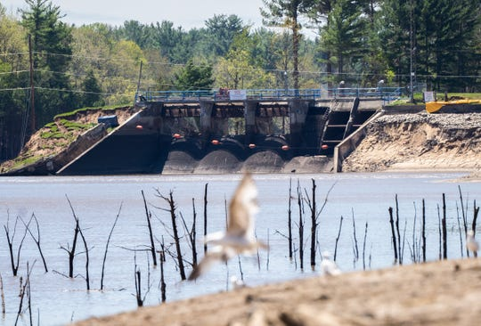 The failed Edenville Dam on Wixom Lake is seen amongst a drained lake that shows tree branches on Thursday, May 21, 2020 after heavy rain caused the dam to fail sending almost all the water into Sanford Lake.