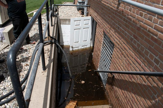 A recently replaced boiler is now under water and being pumped at Holy Scripture Lutheran Church in Midland on Friday, May 22, 2020. Early preparation didn't help church leaders, who don't have flood insurance.