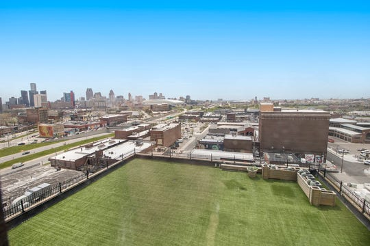 View from the 5,000-square-foot roof terrace shows the three-story penthouse with the steeple of St. Joseph's church in the background. The developer said the buyer can expand the condo into this space if desired.