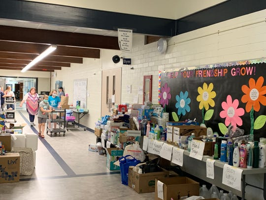 A donation station was created by teachers and administrators at Meridian Elementary School in Sanford for residents impacted by flooding in the area.