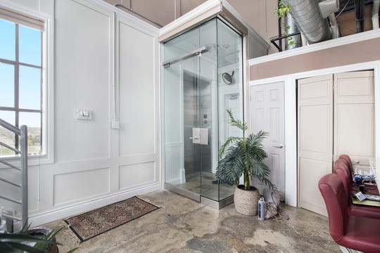 A glass foyer and door make the main entry to this three-story penthouse. This room opens out to a large kitchen and dining area. It's also the level that opens to the large roof terrace.