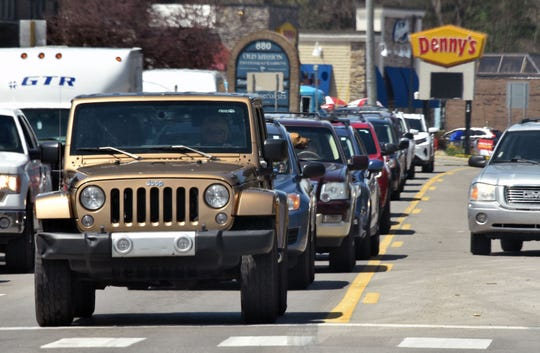 Heavy traffic along US-31 North in East Bay Township near Traverse City signals the beginning of the holiday weekend.