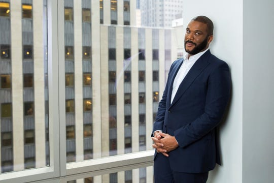In this Nov. 16, 2017, file photo, actor-filmmaker and author Tyler Perry poses for a portrait in New York. Perry is looking to reopen his 330-acre Atlanta-based mega studio soon, but other studios in Georgia are anxiously waiting for Hollywood's green light to return back to work.