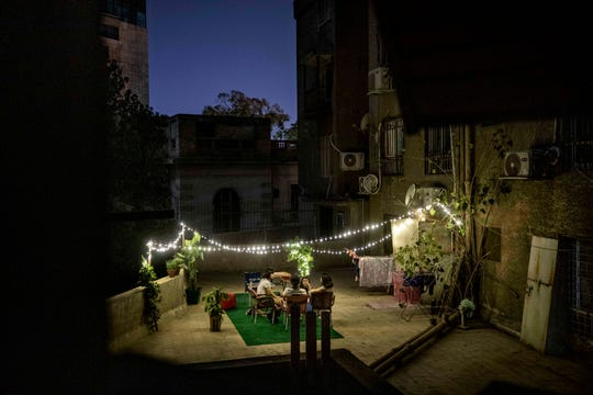 In this May 4 photo, girls gather on a rooftop after Iftar or breaking their fast during Ramadan, in Cairo, Egypt.