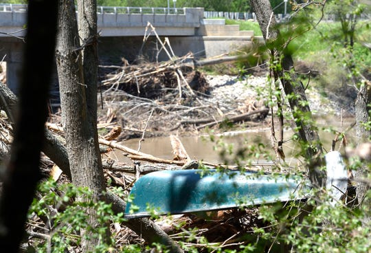 This canoe and other debris is stuck in the trees several feet in the air on the east bank of the Tittabawassee River.