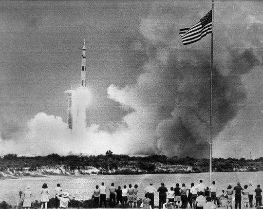 In this April 11, 1970 file photo, crowds watch the lift-off of the Saturn V rocket carrying the Apollo 13 spacecraft on its mission to the moon from Cape Kennedy, Fla.