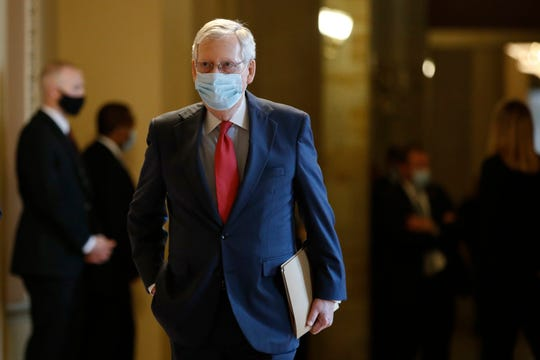Senate Majority Leader Mitch McConnell of Ky., wears a face mask to protect against the spread of the new coronavirus as he walks to the Senate chamber after meeting with Vice President Mike Pence and Treasury Secretary Steve Mnuchin on Capitol Hill in Washington, Tuesday, May 19, 2020.