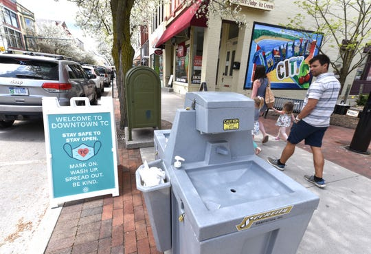 A hand-washing station sits on the sidewalk along Traverse City's East Front Street on Friday. Stations have been placed around the downtown area.
