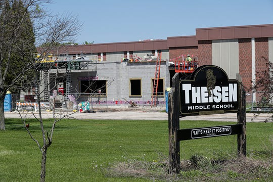 Construction crews work on Theisen Middle School Wednesday, May 20, 2020 in Fond du Lac, Wis as part of a $98 million referendum project to make improvements to four Fond du Lac Schools.