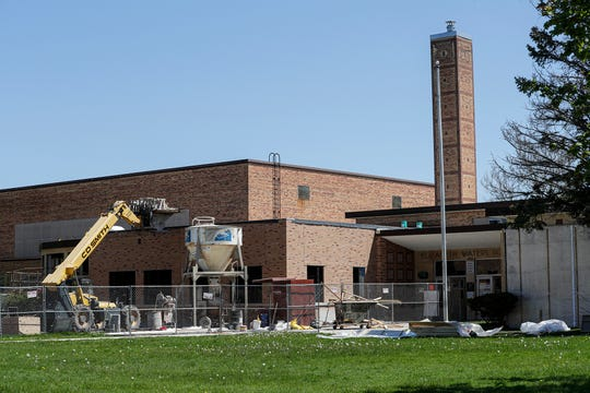 Construction equipment surrounds Waters Elementary School Wednesday, May 20, 2020 in Fond du Lac, Wis. as part of a $98 million referendum project to make improvements to four Fond du Lac Schools.