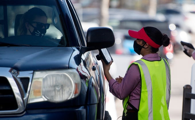 A Chic-fil-A employee works with a customer in the drive-thru in Fort Collins, Colo. on Wednesday, May 20, 2020. Four employees at the Chick-fil-A restaurant at 3605 S. College Ave. have tested positive for COVID-19, according to the Colorado Department of Public Health and EnvironmentÕs latest weekly report.
