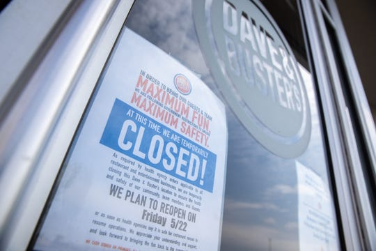 Signage on the front doors of Dave & Buster's on Woodruff Road which remained closed Friday, May 22, 2020 until 4 pm according to posted business hours.