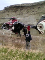 """Mercy Flight first responders prepare to take the bear attack victim. """"That badass pilot landed on a patch of river rock about the size of a small pick-up truck."""""""