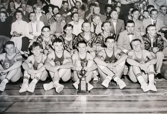 The Gildford Broncs were the Class C state champs in 1960. Team members include (front row, l-r): Chris Pappas, Ken Whitaker, Gene Cady, Ron Nelson, Don Miller, David Welch; (second row) Gary Cady, Monty Borlaug, Richard Swinney, Richard Gummer, head coach Tom McCloskey, manager Wes Whitaker.