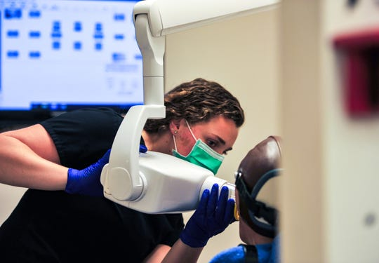 Isabel Hamper, a senior dental hygiene student at Great Falls College-MSU, practices taking radiographs on Thursday, May 21, 2020.  The college resumed in-person instruction on May 18.